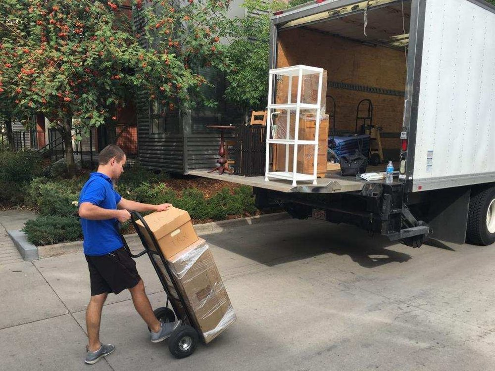 Movers in Denver loading a truck